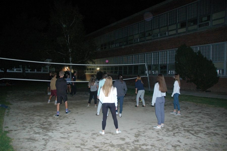 Students enjoy a game of volleyball during the movie night hosted on Wednesday.