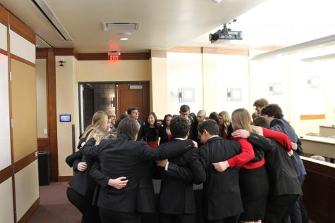 The team huddles together before the start of the competition, a tradition they participated in at Districts as well. The team got second place at Districts, but were able to take first place at State.