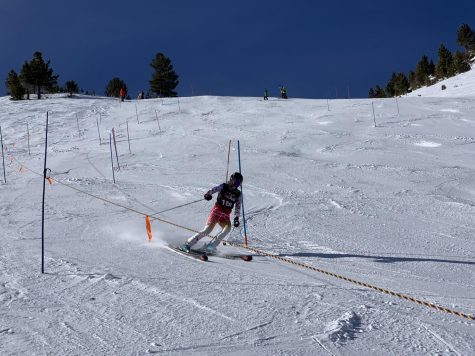 A racer skis down the slope during a race in February. The team has been working on their skills while still having fun.