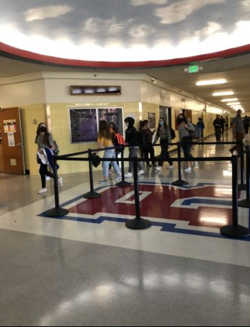 """Students walk around the """"R"""" and wear masks to follow COVID-19 restrictions."""